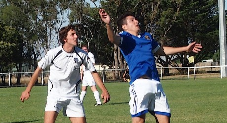 Action between Lara United (in white) and Golden Plains in the group stages of the Community Cup.
