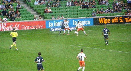 Matt Kemp and Kosta Barbarouses struggling for the ball. Photo: Roy Hay
