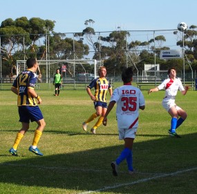 Action from the match between North Geelong Youth (in white) and Surfcoast in the Morris Finance Cup at Bell Park Sports Club.